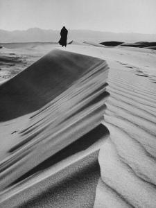 Man Wearing a Dog Skin Coat in the Gobi Desert by Howard Sochurek