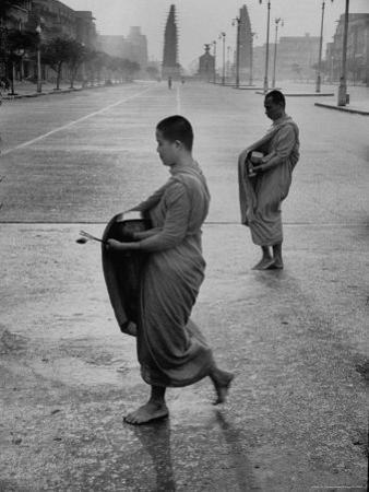 Monks Begging For Food at Dawn on Main Thoroughfare of Bangkok