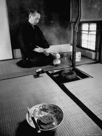 Old Monk Sitting in Cell Meditating and Performing Tea Ceremony