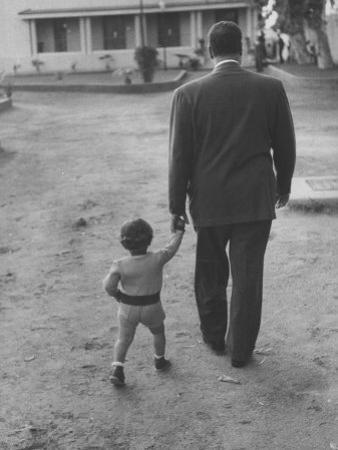 President Gamal Abdul Nasser at His Home with His Small Son Just after Port Said Invasion