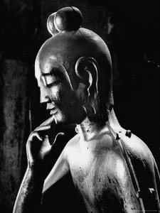Statue of Kwan Yin, Buddhist Impersonation of Wisdom and Compassion by Howard Sochurek