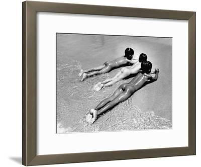 Three Native Boys Sunbathing Nude at the Edge of the Surf at Ocean Beach