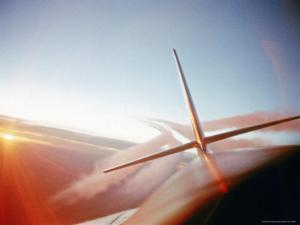 Vapor Trails Streaming from Tail of Jet in Flight by Howard Sochurek