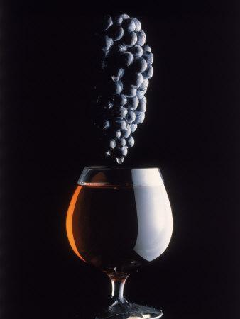 Bunch of Grapes Over a Glass of Wine