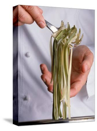 Chef Holding Pasta Over Pot