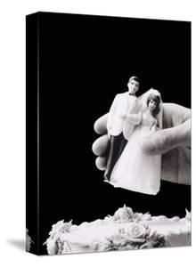 Female Hand Holding Wedding Cake Topper by Howard Sokol