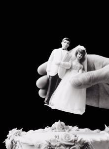Female Hand Holding Wedding Cake Topper by Howard Sokol