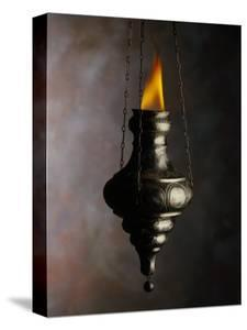 Flame in Jewish Oil Lamp by Howard Sokol