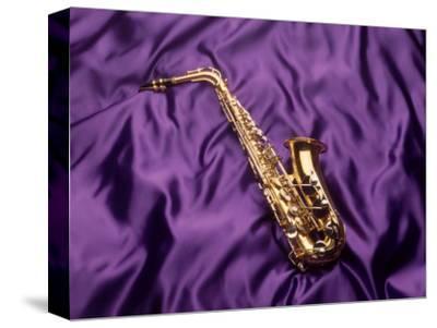 Saxophone on Purple Background