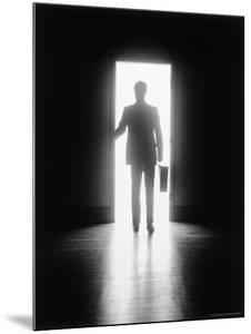 Silhouette of Businessman in Doorway by Howard Sokol