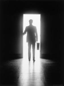 Silhouette of Businessman in Doorway by Howard Sokol