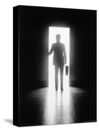 Silhouette of Businessman in Doorway
