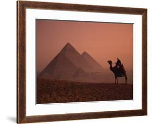 Camel and Rider at Giza Pyramids, UNESCO World Heritage Site, Giza, Cairo, Egypt by Howell Michael
