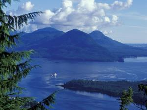 Aerial View of Boat and Annette Island near Ketchikan, Inside Passage, Alaska, USA by Howie Garber