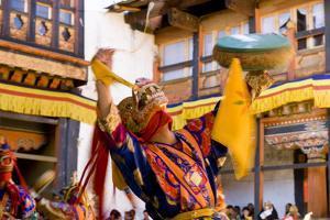 Dancers at Jakar Festival at Jakar Dzong, Bumthang, Bhutan by Howie Garber