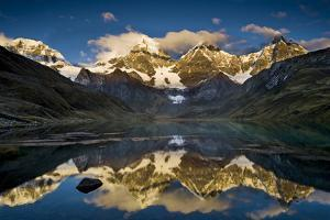 Mount Yerupaja Reflects in Lake Huayhuish, Andes Mountains, Peru by Howie Garber