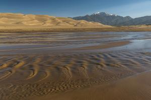 Sunrise at Great Sand Dunes and Medano Creek by Howie Garber