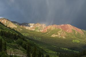 Virga and Storm Moving over Mountains in Colorado by Howie Garber