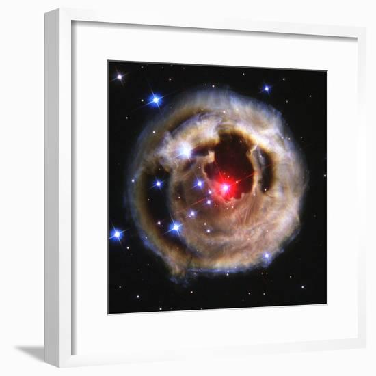 Hubble Captured a Cosmic Spectacle - Expanding Blast of Star Light Lluminating a Dust Cloud--Framed Photographic Print