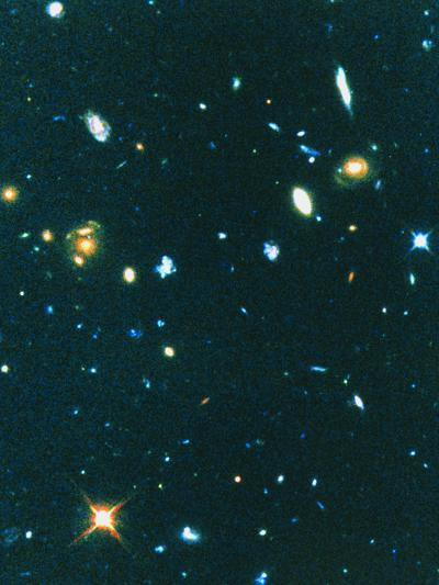 Hubble Image of Distant Irregular Blue Galaxies--Photographic Print