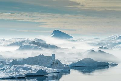 Huge Stranded Icebergs at the Mouth of the Icejord Near Ilulissat at Midnight, Greenland-Luis Leamus-Photographic Print