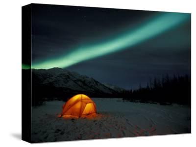 Camper's Tent Under Curtains of Green Northern Lights, Brooks Range, Alaska, USA