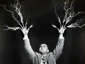Man with Lightning Shooting from Fingers (B&W) by Hulton Archive