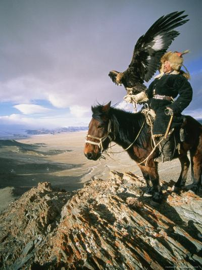 Hunter on Horseback Atop a Hill Holding a Golden Eagle in Mongolia-David Edwards-Photographic Print