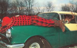 Hunter Strapped to Fender, Deer Driving