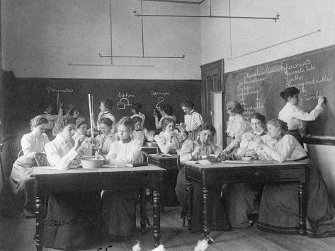 Photographic Print: Young women performing atmospheric pressure experiments in normal school, Washington D.C., c.1899 by Frances Benjamin Johnston : 2