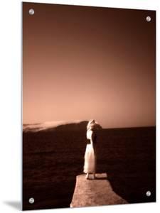 Lone Woman Standing on Jetty, Malta, Orange Toned by I.W.