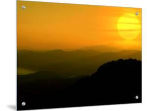 Sunrise Above Rolling Mountain Range by I.W.