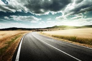 Asphalt Road in Tuscany Italy by Iakov Kalinin