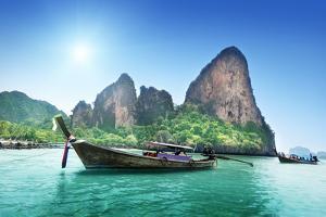 Boats on Railay Beach in Krabi Thailand by Iakov Kalinin
