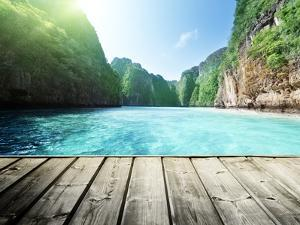 Rock of Phi Phi Island in Thailand and Wooden Platform by Iakov Kalinin
