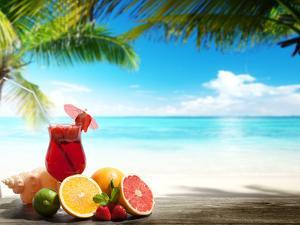 Strawberry Cocktail and Tropical Fruit on the Beach by Iakov Kalinin