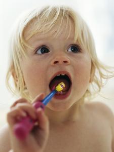 Baby Girl Brushing Teeth by Ian Boddy