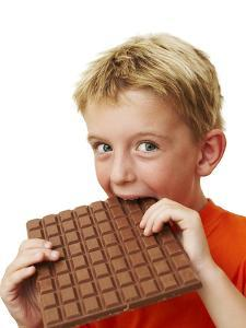 Boy Eating Chocolate by Ian Boddy