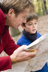 Father And Son Reading a Map by Ian Boddy