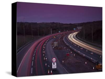 Roadworks, Lane Closures and Speed Limits on M5 Motorway at Dusk, Near Birmingham, England
