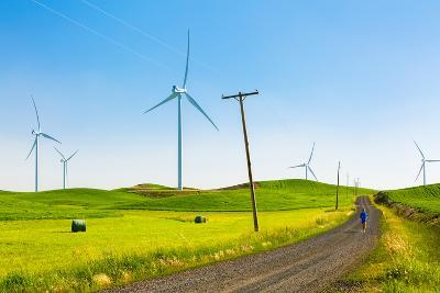 Ian Engerbretson Running Amidst Giant Windmills On A Spring Day In South East Washington State-Ben Herndon-Photographic Print