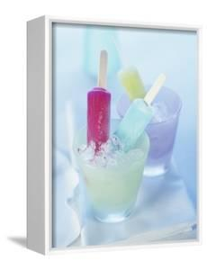 Coloured Ice Lollies in Glasses of Crushed Ice by Ian Garlick