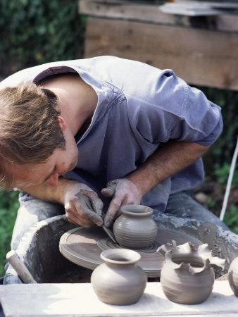 Potter at Work on Wheel at Rustic Fayre, Devon, England, United Kingdom
