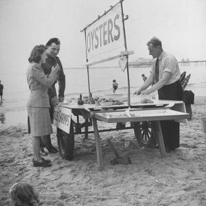 Couple Buying Seafood at Blackpool Beach by Ian Smith