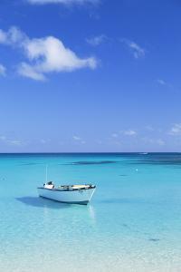 Boat on Blue Lagoon, Nacula Island, Yasawa Islands, Fiji by Ian Trower