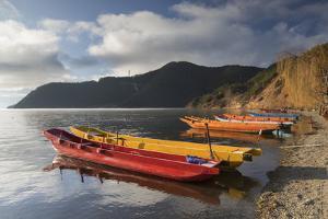 Boats on Lugu Lake, Lige village, Yunnan, China, Asia by Ian Trower