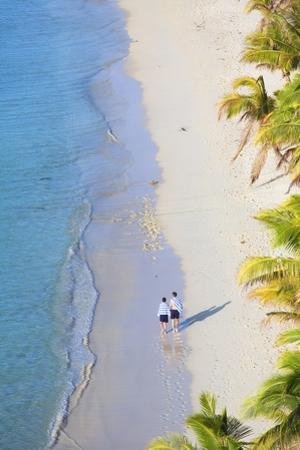 Boys Walking on Beach at Mana Island Resort, Mana Island, Mamanuca Islands, Fiji by Ian Trower