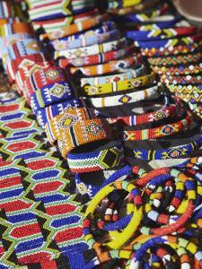 Colourful Traditional African Souvenirs on Beachfront, Durban, Kwazulu-Natal, South Africa by Ian Trower