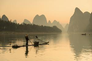 Cormorant Fisherman on Li River at Dawn, Xingping, Yangshuo, Guangxi, China by Ian Trower