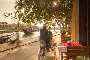 Cyclos Passing Restaurant, Hoi an (Unesco World Heritage Site), Quang Ham, Vietnam by Ian Trower